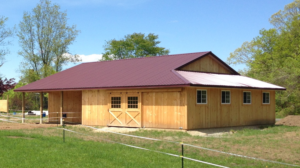 Horse barn with wrap around lean-to and open porch