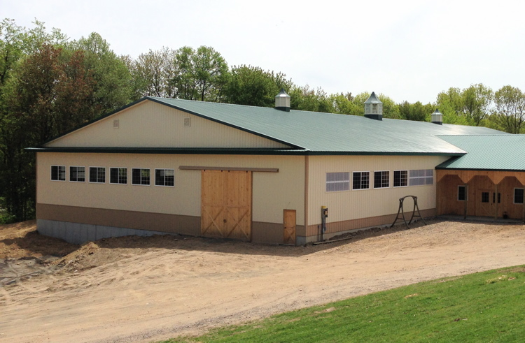 Front view of new arena with office area and porch
