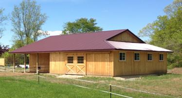 Horse barn measures 40X50 with an enclosed lean-to and open porch