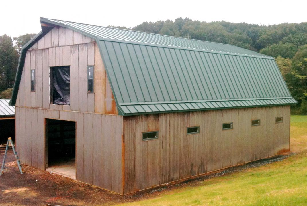 This 2-story pole barn has a Gambrel style roof and measures 40ft wide x 60ft long. The 1st floor has a 12ft ceiling, with the 2nd floor ceiling being 14ft at its highest point.  Features: -Designed to accommodate five 12ft x 12ft horse stalls, with room for a wash bay, tack-room and clubhouse. -Enclosed 36in wide stairway to 2nd floor -Standing-seam metal roof with vapor barrier and insulation -12x10 doorway at each gable end and a 8x8 loft door on 2nd floor with functional pulley hoist  -22-gauge corrugat